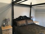 Master bedroom with four poster king size bed and ensuite facilities