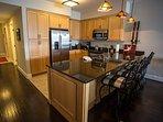 Open kitchen area w stainless appliances