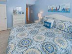 Tiled master bedroom with king bed and double dresser