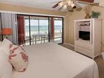 Master bedroom with flat screen TV and private access to Gulf-front balcony