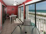 Enclosed balcony overlooking beach and Gulf