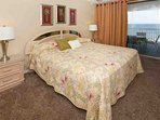 Carpeted master bedroom with king bed