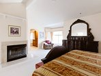 Spacious Master Bedroom with Cal-King Bed, Dresser-set, fireplace, chair...