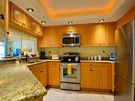 Modern appliances and granite counterops in the kitchen