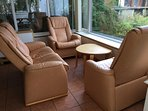 Comfortable leather seating in the sunroom.