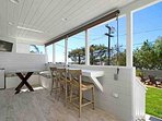 Deck off back of house with ocean views, TV and refrigerator