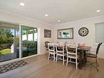 Dining room shows off the beautiful wood floors and opens to deck and back yard