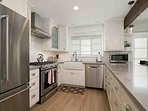 Newly remodeled kitchen with stainless appliances and gas stove