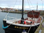 Local fishing boat in Anstruther harbour. You can book fishing trips.