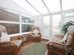 conservatory leading onto back garden through patio doors