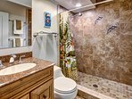 our master bathroom, walk in shower with the granite inlaid dolphins