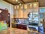First Class Bamboo cabinet uppers with raised bamboo glass/espresso lower cabinets/double oven