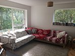 Upstairs living room - stretch out on the couch with a good book, a cuppa and watch the birds too