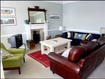 Cosy sitting room with wood burning stove, contemporary and local art