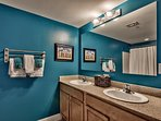 Bathroom with dual sinks and private toilet closet attached to each bdrm