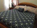 Second bedroom, queen bed, flat screen TV and A/C