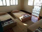 Dorm room with 4 beds (THB170/person/night when booked directly; in booking website THB30 fee extra.
