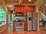 The kitchen extends across the area to provide you with these essential appliances.