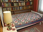 Bedroom five: a single bed and a thousand books