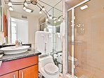 Main bathroom has large walk in shower stall and designer basin.