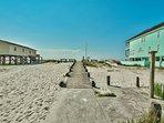beach boardwalk, about a 2-min walk, trash cans, showers, toilets