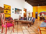 You'll love the thick adobe walls, vibrant color accents and open-beam ceilings.