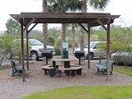 Pergola w/picnic table and grill.