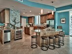 Huge kitchen has TWO center islands, one with six barstools. Fully outfitted!