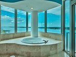 soak away your stresses in jacuzzi tub with views of lagoon