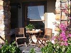 Bask in the morning sun on the private outdoor veranda of the Garden studio