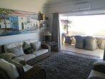 Lounge with bi-fold doors open onto large terrace