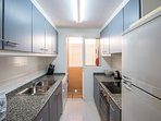 Kitchen with Nespresso coffee machine, oven, microwave, fridge, dishwasher and washing machine