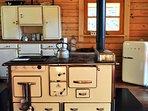Im Blockhaus auf dem Holzherd ein leckeres Abendessen kochen, so wie bei 'Oma'