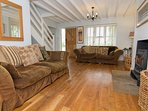 Two large sumptuous sofas to relax on in front of the welcoming Clearview wood burning stove.