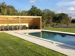 Pool and seating area for guests to relax and enjoy