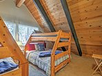 The kids will love the bunk beds in this inviting bedroom!