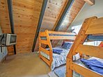 The bunk room features 2 twin-over-full bunk beds and 2 twin trundles.