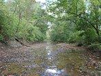 Sandy Creek with runs through the property
