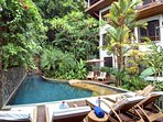 Elegant style outdoor lap pool with jungle views, enough room for the entire family