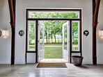 Front imported Italian marble entryway opens to view of neighboring Vanderbilt estate