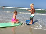 Our granddaughter learning how to surf