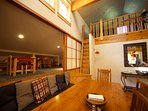 Two lofts each have a queen bed and twin. Dinner table hosts ten.