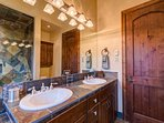 This bathroom however, has a dual sink vanity as well a shower/tub combo.