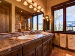This one has a dual sink vanity and, of course, another angle on your beautiful view.