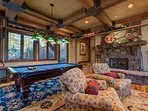 Get this fireplace going and maybe challenge someone to a game of pool.