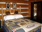 The master bedroom with our handmade mountain style queen bed and wardrobe.