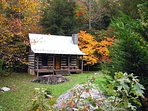 Fall foliage surrounds the cabin and the area from mid-October until mid-November.