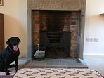 The open fire in the sitting room