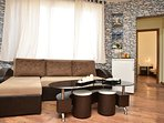 cliving room with sofas.all equipped.2 person, connect with full equipped kitchen and bathroom