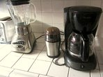 All the makings for breakfast!  Toaster, blender, and coffee grinder and maker.
